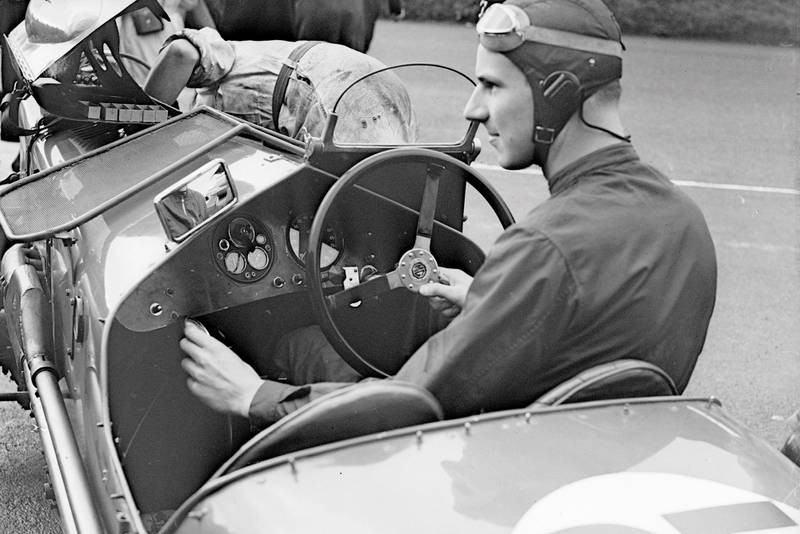 Richard Seaman (1913 - 1939) at the wireless control of an MG car during the Royal Automobile Club Tourist Trophy race practice in Belfast