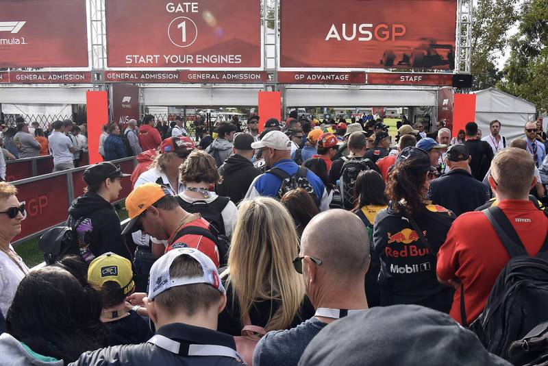 Fans queue outside Melbourne's Albert Park circuit before the 2020 Australian Grand Prix was cancelled