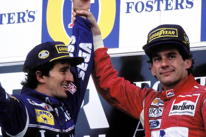 Ayrton Senna raises Alain Prost's arm in the air after winnin his final race at the 1993 Australian Grand Prix