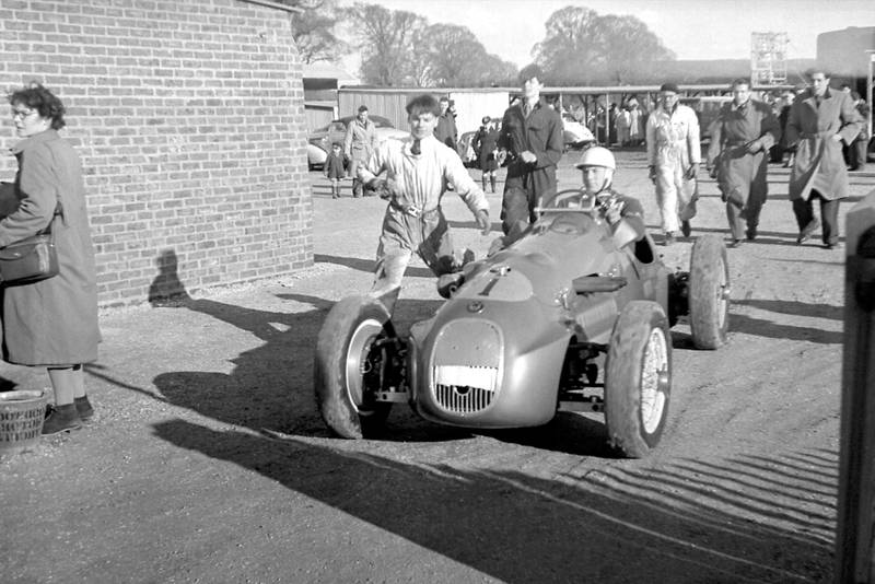 Stirling Moss in his HWM in the Goodwood paddock 1951