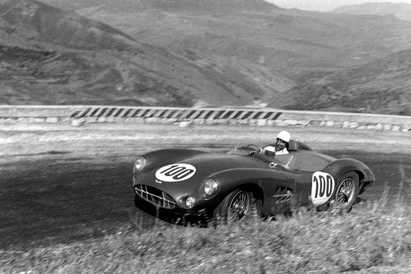 Stirling Moss climbs a hill in his Aston Martin DBR1 during the 1958 Targa Florio