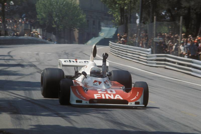 Arturo Merzario raises his hand in protest over safety as he withdraws from the 1975 Spanish Grand Prix at Montjuich Park