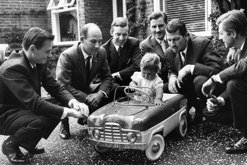 A young Damon Hill in a toy car with Bruce McLaren Stirling Moss Tony Brooks Graham Hill Jo Bonnier and Wolfgang von Trips