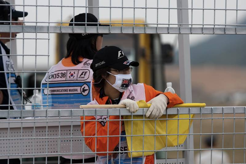An F1 marshal wearing a face mask