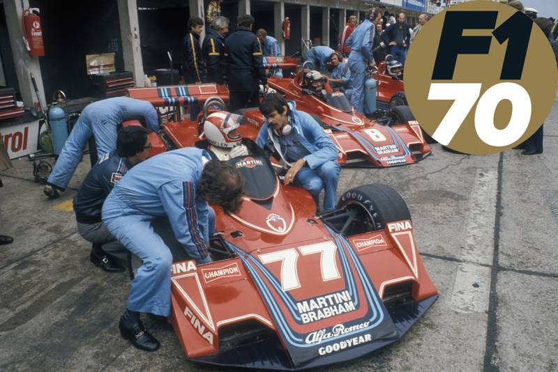 Gordon Murray speaks to Rolf Stommelen in his Brabham BT45 in the pits at the 1976 German Grand Prix