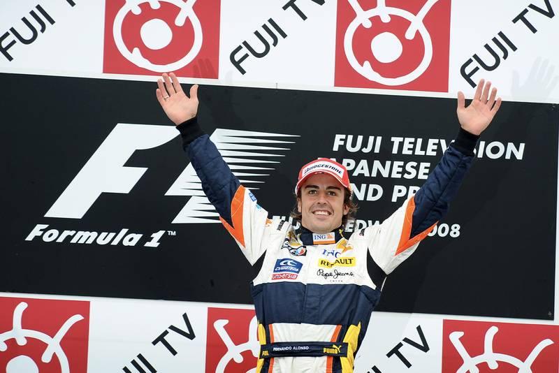 Fernando Alonso celebrates victory on the podium at the 2008 Japanese Grand Prix