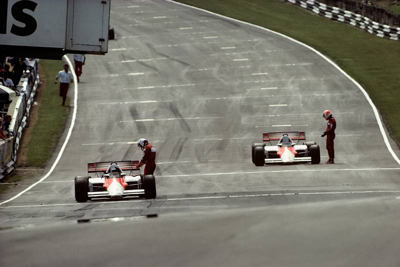 Alain Prost and Niki Lauda on the grid after a red flag stopped the 1984 British Grand Prix