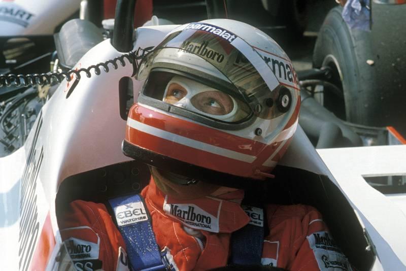 Niki Lauda in his McLaren Ford with his helmet on in 1982