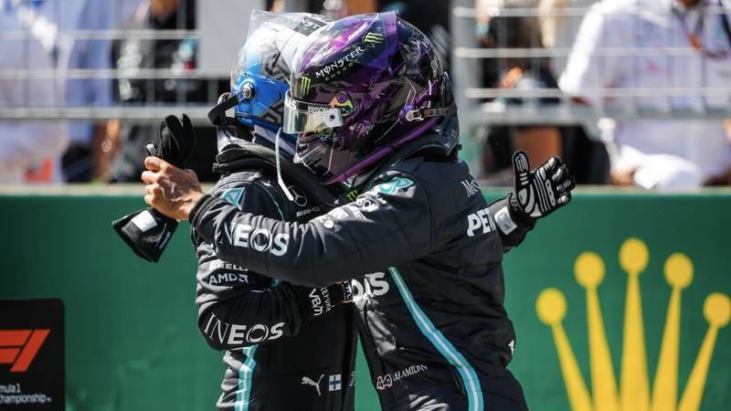 Lewis Hamilton and Valtteri Bottas in a celebratory hug after qualifying 1-2 for the 2020 F1 Austrian Grand Prix