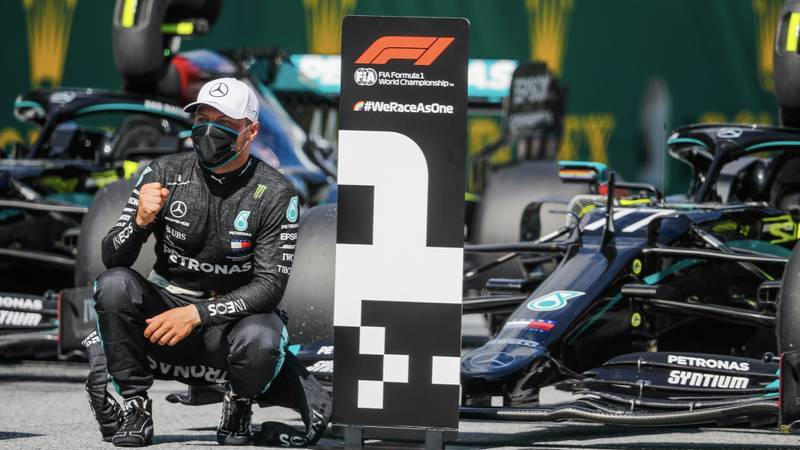 Valtteri Bottas in front of his Mercedes W11 after qualifying first for the 2020 Austrian Grand Prix