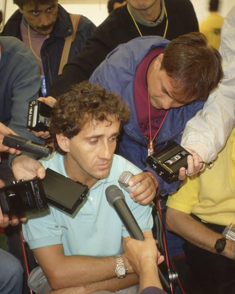 Alain Prost being interviewed.