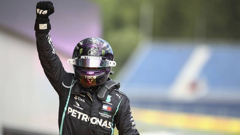 Lewis Hamilton raises his hand in the air after winning the 2020 F1 Styrian Grand Prix at the Red Bull Ring