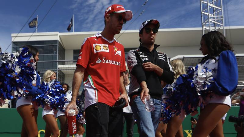 Sebastian Vettel with Sergio Perez at the Circuit of the Americas US F1 Grand Prix in 2016