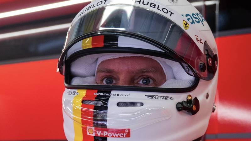 Sebastian Vettel looks out from his helmet