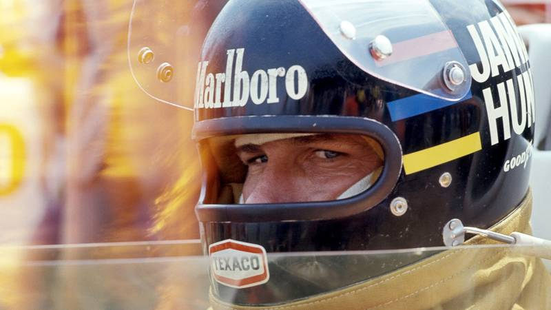 James Hunt stares out from behind his helmet while sat in the copckpit at Brands Hatch for the 1976 Formula 1 British Grand Prix
