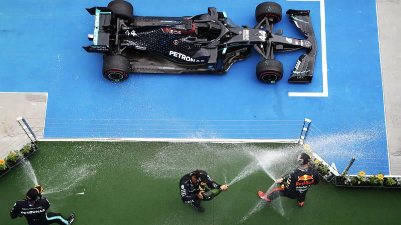Overhead view of champagne spraying on the podium and Lewis Hamilton's winning Mercedes after the 2020 Formula 1 Hungarian Grand Prix