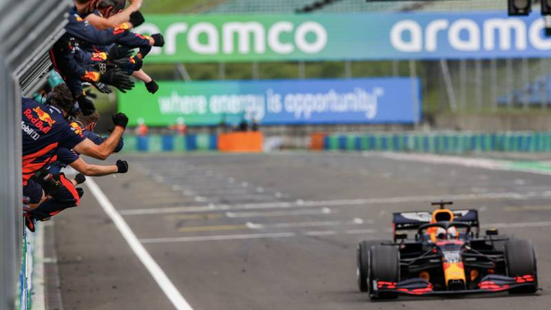 The Red Bull team cheer Max Verstappen as he crossed the line to take second place int he 2020 F1 Hungarian Grand Prix