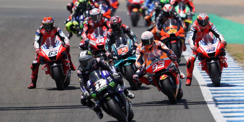 Maverick Vinales pursued by Marc Marquez at the start of the 2020 MotoGP Spanish Grand Prix