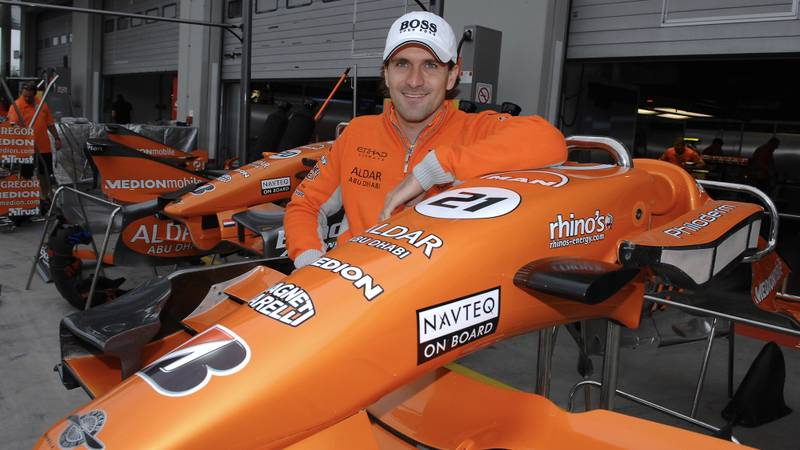 Markus Winkelhock next to a Spyker nosecone ahead of his only F1 drive at the 2007 European F1 Grand Prix at the Nurburgring