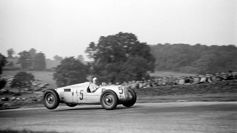 The back wheels of Bernd Rosemeyer's Auto Union lidt in the air over Melbourne Rise during the 1937 Donington Park Grand Prix