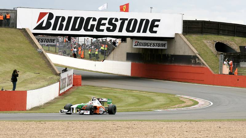 Adrian Sutil's Force India drives away from Bridge Corner at Silverstone in 2009