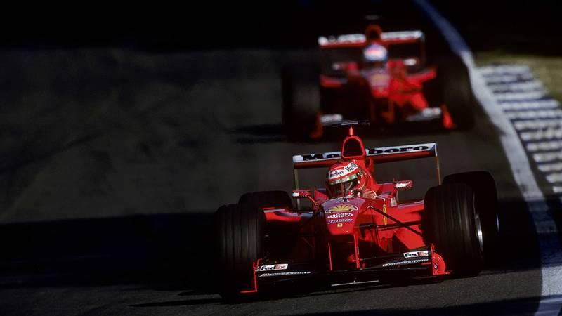 Eddie Irvine leads Mika Salo in the 1999 F1 German Grand Prix at Hockenheim