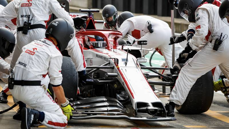 Kimi Raikkonen in the Silverstone pits during the 2020 F1 British Grand Prix with a broken front wing