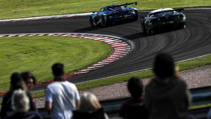 Spectators watch the British GT cars at Oulton Park in 2020