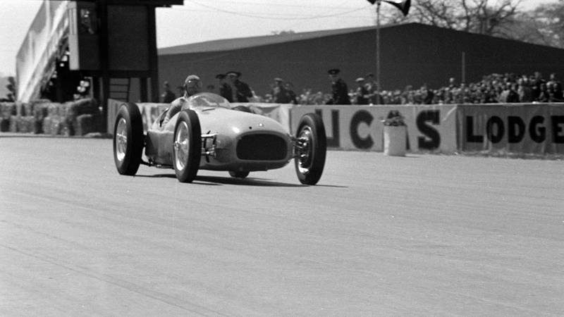 Raymond Mays demonstrates a BRM V16 before the start of the Grand Prix during the British GP at Silverstone on May 13, 1950 in Silverstone