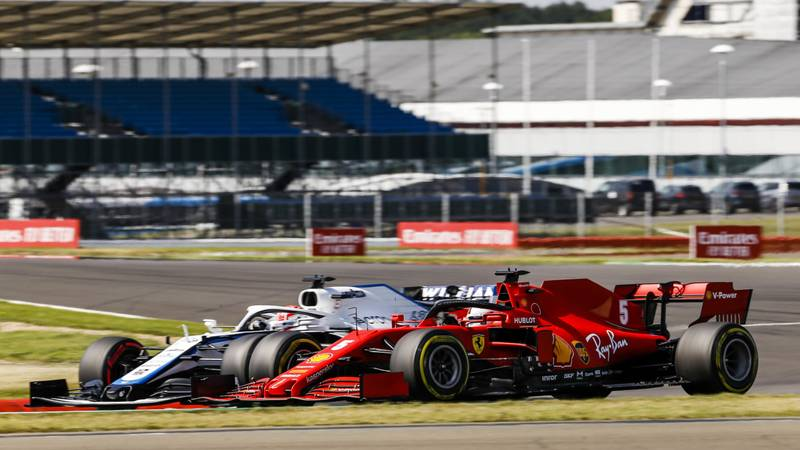 Sebastian-Vettel-alongside-Geroge-Russell-during-qualifying-for-the-2020-F1-70th-Anniversary-Grand-Prix-at-Silverstone