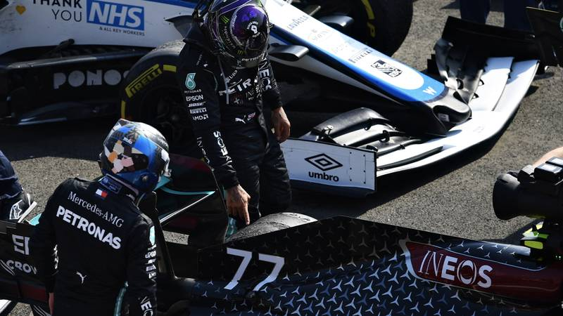 Valtteri Bottas and Lewis Hamilton examine the tyre damage to Bottas' Mercedes at the end of the 2020 F1 70th Anniversary Grand Prix