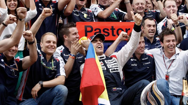 The Williams team celebrate with Pastor Maldonado after winning the 2012 F1 Spanish Grand Prix