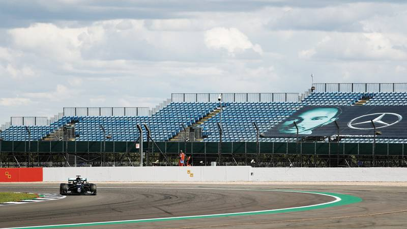 Lewis Hamilton racing in front of empty grandstands at Silverstone in 2020