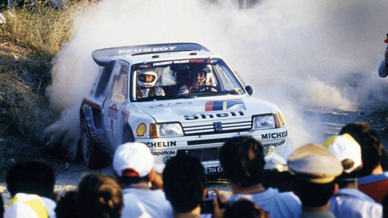 Timo Salonen drives through a water splash in his Peugeot 205 T16 in the 1986 Sanremo Rally
