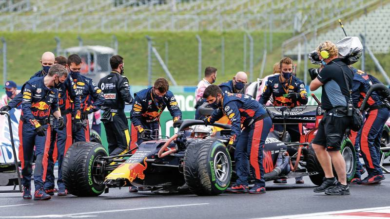 Max Verstappen's damaged car is pushed to the grid ahead of the 2020 Hungarian Grand Prix