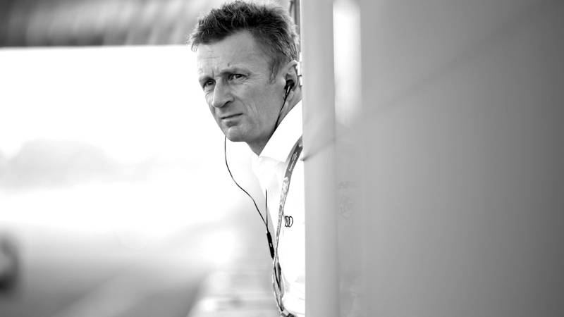 Allan McNish leans over to the track from a pitlane