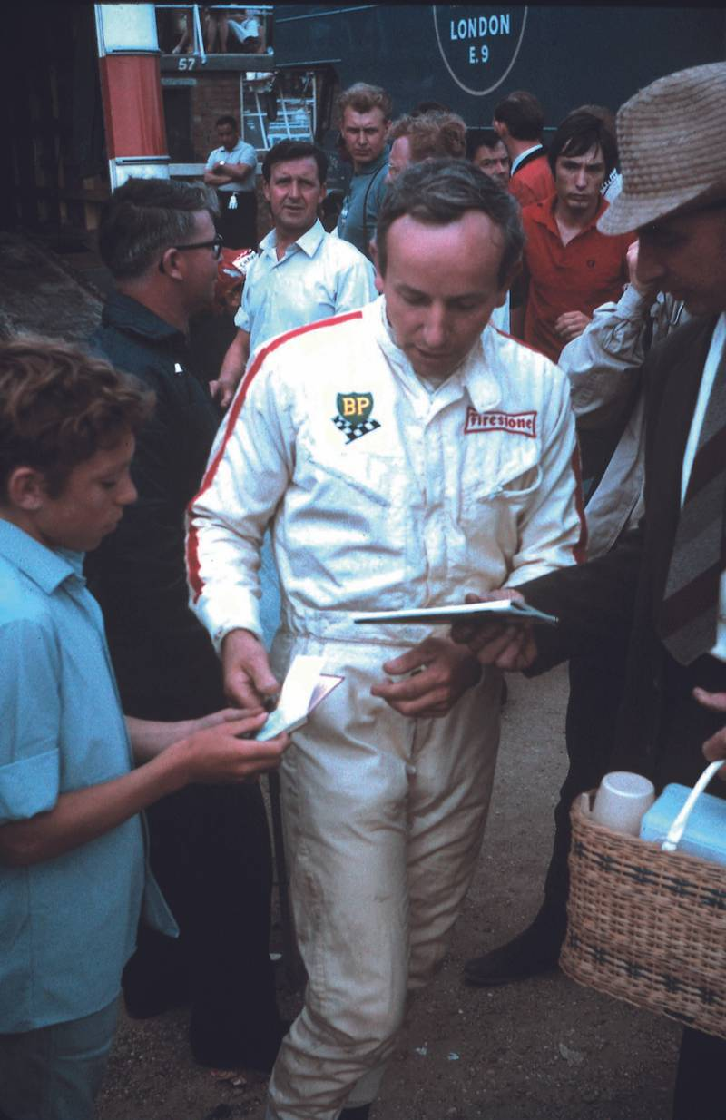 John Surtees signing autographs at the Brands Hatch Race of Champions