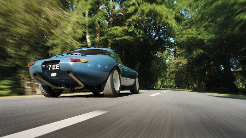Rear shot of the 2020 Eagle E-type Lightweight GT and its exhaust pipes ona. country road
