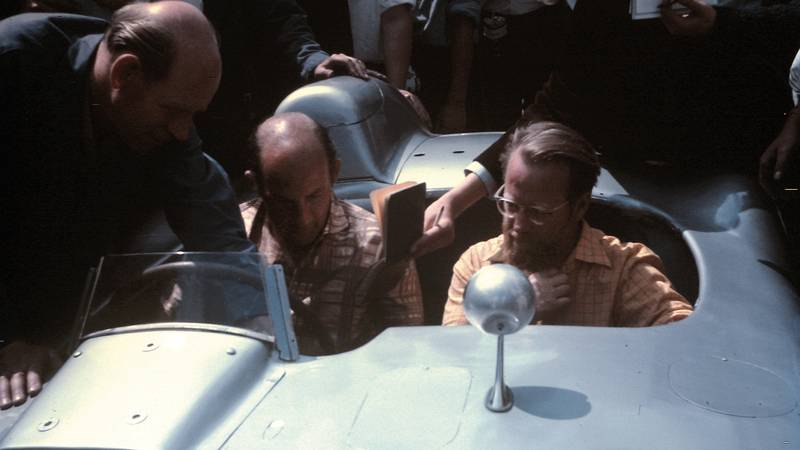 Stirling Moss and Denis Jenkinson in the paddock at Silverstone for the 1967 British Grand Prix