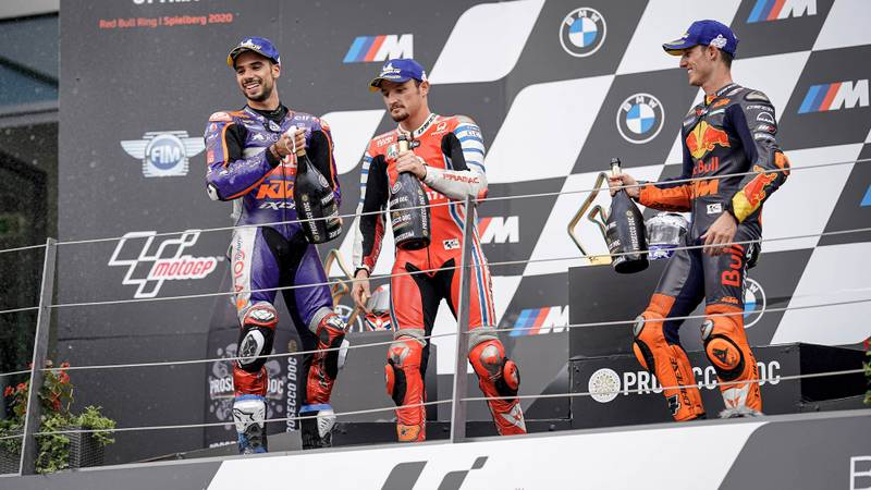 Miguel Oliveira Jack Miller and Pol Espargaro on the MotoGP podium at the Red Bull ring ater the 900th premier class motorcycle grand prix