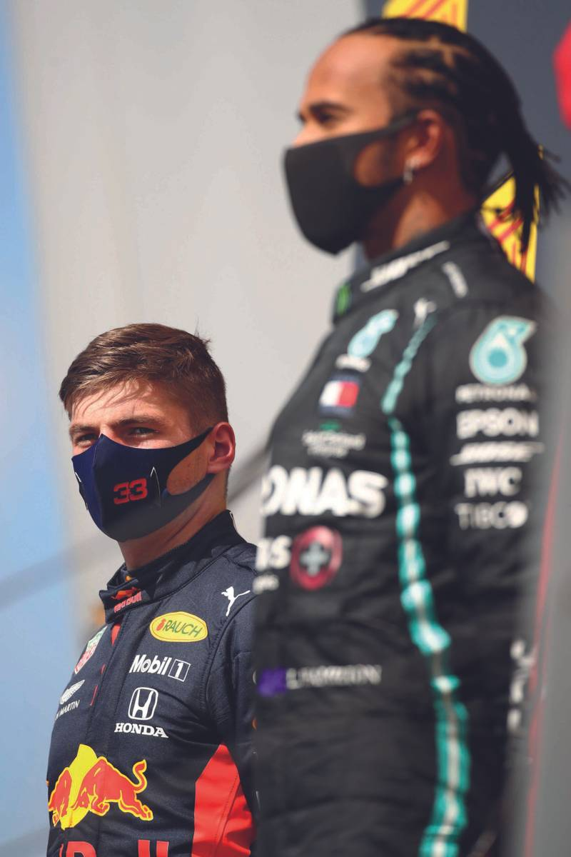 Lewis-Hamilton-on-the-podium-next-to-Max-Verstappen-after-winning-the-2020-Spanish-Grand-Prix-at-Barcelona