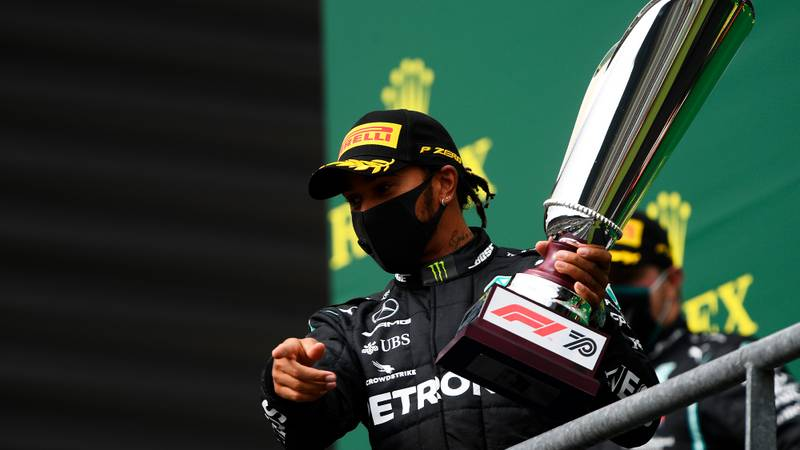 Lewis Hamilton lifts the trophy after victory in the 2020 F1 Belgian Grand Prix
