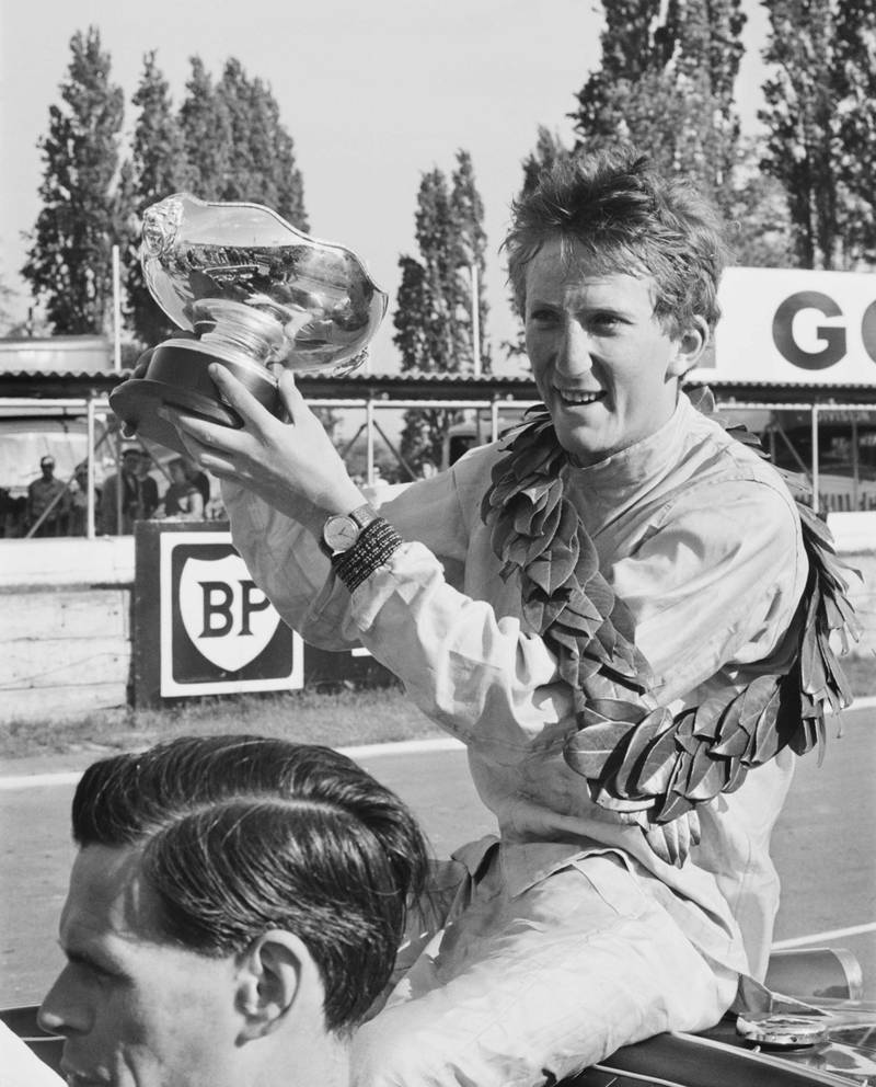 German racing driver Jochen Rindt holding his trophy after winning the 'London Trophy' Formula 2 race at the Crystal Palace circuit, UK, 18th May 1964.