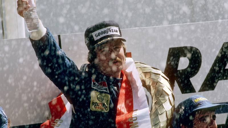 Keke Rosberg on the podium after winnng the 1982 Grand Prix of Switzerland at Dijon