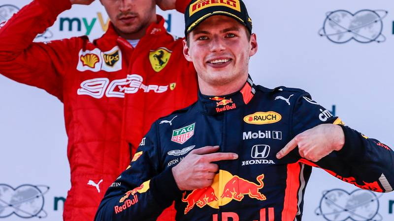Max Verstappen points at his Honda badge after winning the 2019 F1 Austrian Grand Prix