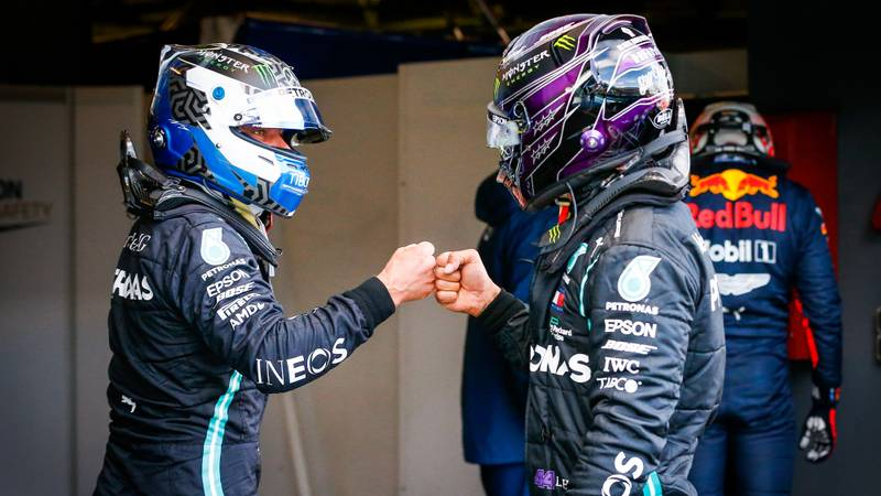 Valtteri Bottas and Lewis Hamilton bump fists after qualifying 1-2 at the Nurburgring for the 2020 F1 Eifel Grand Prix