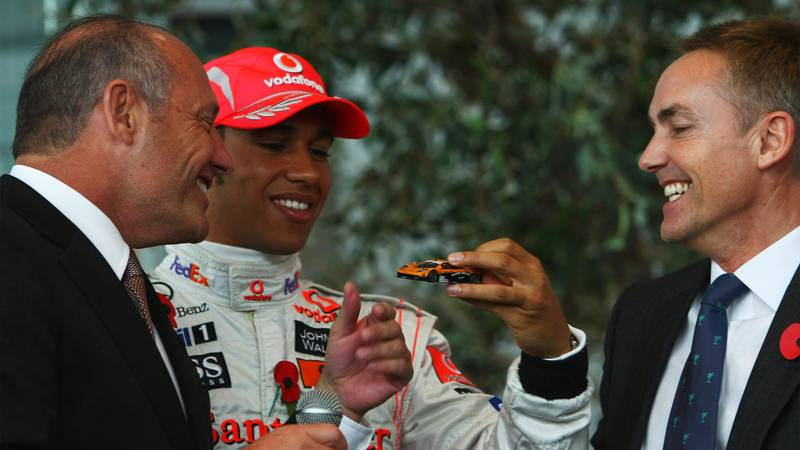 Lewis Hamilton is presented with a McLaren F1 model by Ron Dennis and Martin Whitmarsh in 2008
