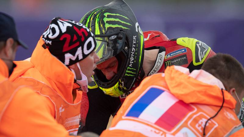 Cal Crutchlow is helped by marshals after crashing out of the 2020 MotoGP French Grand Prix at Le Mans