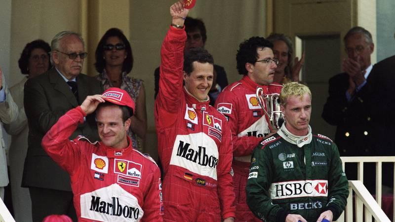 Michael Schumacher celebrates winning in Monaco alongside Rubens Barrichello and Eddie Irvine